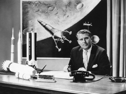 Werner von Braun (1912-1977) the German-born American rocket engineer with model rockets. He was director of the American Army team that put the first satellite Explorer I into space in 1958. (Photo by © Hulton-Deutsch Collection/CORBIS/Corbis via Getty Images)